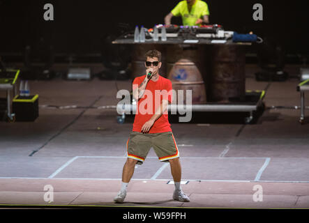 Naples, Italy. 26th July, 2019. The italian rapper Dani Faiv opens the concert of singer and songwriter Maurizio Pisciottu known as Salmo during the 'Playlist Summer Tour' at Noisy Fest in Naples. Credit: SOPA Images Limited/Alamy Live News - Stock Photo