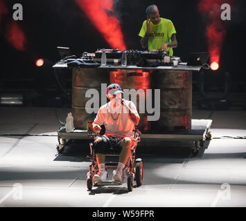 Naples, Italy. 26th July, 2019. The italian rap rock singer and songwriter Maurizio Pisciottu known as Salmo performing live during the 'Playlist Summer Tour' with DJ Slait behind him at Noisy Fest in Naples. Credit: SOPA Images Limited/Alamy Live News - Stock Photo