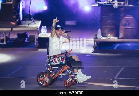 Naples, Italy. 26th July, 2019. The italian rap rock singer and songwriter Maurizio Pisciottu known as Salmo performing live during the 'Playlist Summer Tour' at Noisy Fest in Naples. Credit: SOPA Images Limited/Alamy Live News - Stock Photo