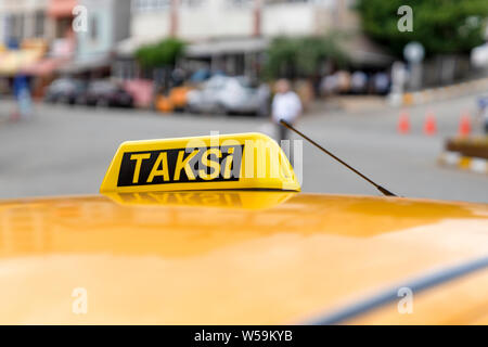 Taxi sign on the roof of taxi. Waiting taxi on the street. Yellow cab in Turkey. - Stock Photo