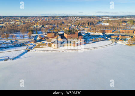 View of the frozen Vanajavesi  lake and the ancient fortress off Hameenlinna on a sunny March morning (aerial survey). Finland - Stock Photo