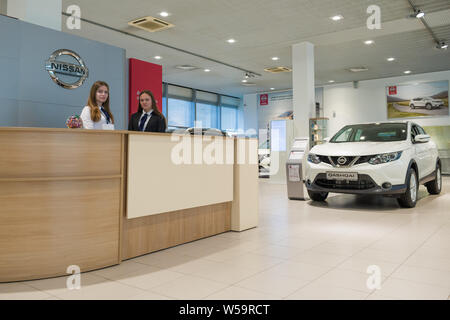 ST. PETERSBURG, RUSSIA - JULY 09, 2019: Two girls on a reception in a motor show of the official dealer of the Nissan company - Stock Photo