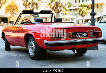 Rome,Italy - July 20, 2019:On occasion of  Rome capital city Rally event, an exhibition of vintage cars has been set up with the beutiful red car mode - Stock Photo