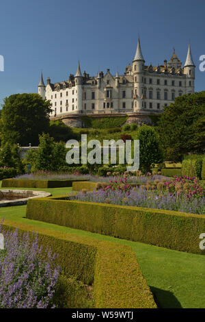 A view of Dunrobin Castle and gardens in the summer sunshine at Golspie, Scottish Highlands