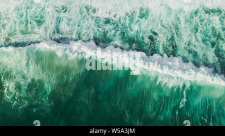 Aerial wave background. Drone shot directly from above, green turquoise color, huge waves. Empty space - Stock Photo