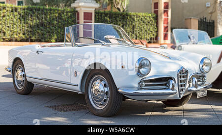 Rome,Italy - July 20, 2019: On occasion of  Rome capital city Rally event, an exhibition of vintage cars has been set up with the beutiful white car m - Stock Photo