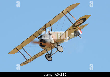 Sopwith Camel replica First World War, Great War biplane fighter plane flying at Hood Aerodrome, Masterton, New Zealand in blue sky. Space for copy - Stock Photo