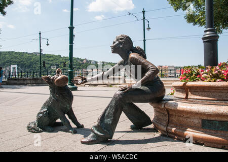 Around Budapest - A girl with her dog - sculpture on the banks of the River Danube - Stock Photo