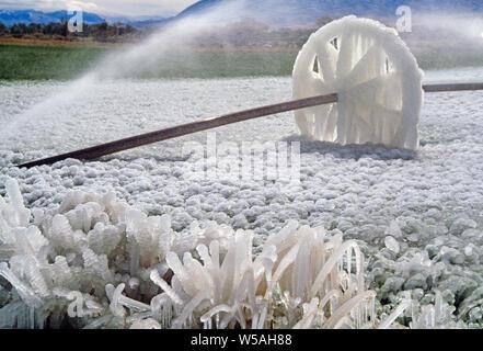 USA. Montana. Ice on Irrigation machine wheel. - Stock Photo
