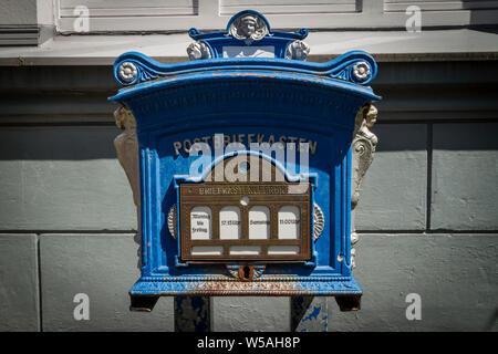 historical mailbox in the district Werden, Essen, Ruhr Area, Germany.  historischer Briefkasten im Stadtteil Werden, Essen, Ruhrgebiet, Deutschland. - Stock Photo