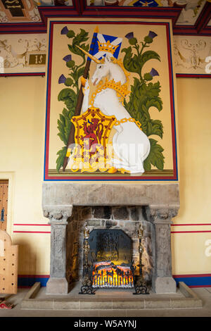 Restored fireplace and tapestry in the Kings Bedchamber within the Royal Palace - Stirling Castle, Scotland, UK