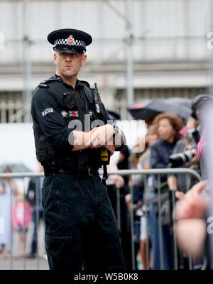 Manchester, UK, 27th July, 2019. A Police Officer on duty as Prime Minister Boris Johnson is  leaving the Science and Industry Museum, Manchester, UK. Credit: Barbara Cook/Alamy Live News - Stock Photo