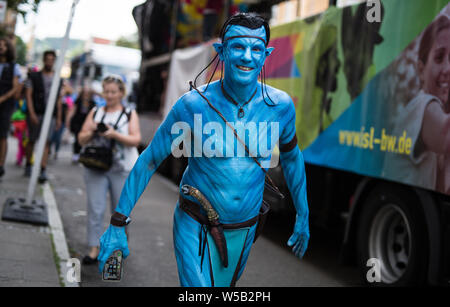 Stuttgart, Germany. 27th July, 2019. Dressed up as an avatar, a participant in the Christopher Street Day (CSD) parade is going through the city centre. The political parade stands for the rights of gays, lesbians, bisexuals and transgender people under the motto 'Courage to Freedom'. Credit: Christoph Schmidt/dpa/Alamy Live News - Stock Photo