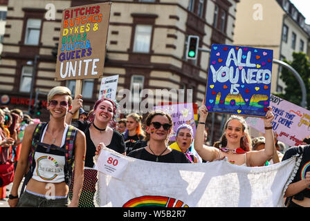 Stuttgart, Germany. 27th July, 2019. Participants march through the city centre at the Christopher Street Day (CSD) parade. The political parade stands for the rights of gays, lesbians, bisexuals and transgender people under the motto 'Courage to Freedom'. Credit: Christoph Schmidt/dpa/Alamy Live News - Stock Photo
