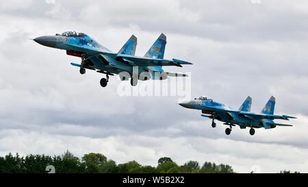 Pair of Su-27 Flanker fighter jets from the Ukrainian Air Force arriving at the 2019 Royal International Air Tattoo - Stock Photo