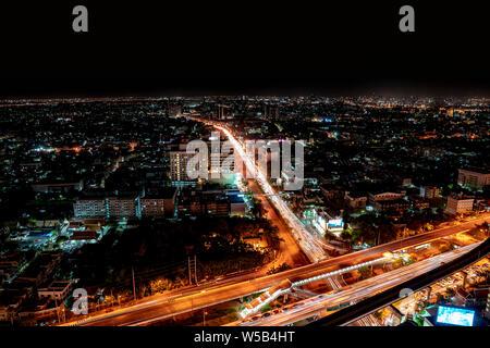 BANGKOK, THAILAND - 31 Oct, 2018: Bangkok cityscape from top of BTS skytrain Talat phlu station in the night, Thailand. - Stock Photo