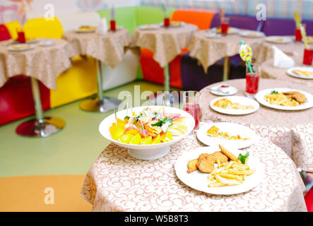Child Birthday party table. Table setting in the restaurant. - Stock Photo