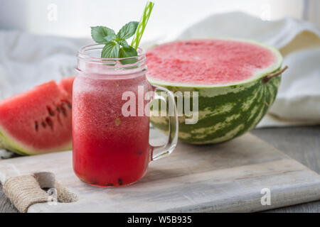 Photo of watermelon smoothie in jar with straw on light background. Fresh organic Smoothie. Health or detox diet food concept. - Stock Photo