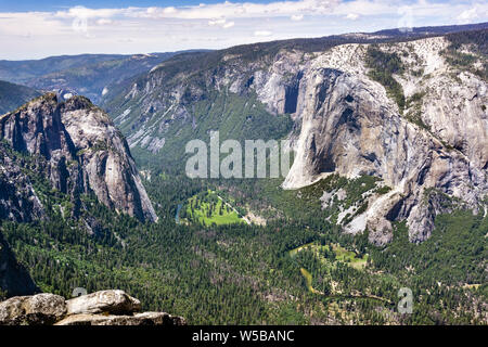 Aerial view of Yosemite Valley, with Merced Rriver flowing through evergreen forests, El Capitan visible on the right; Yosemite National Park, Califor - Stock Photo