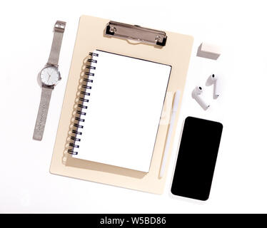 Cellphone with black blank screen on Office table with supplies - Stock Photo