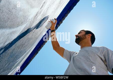 Man Painting Graffiti Along The Camino de Santiago - Stock Photo