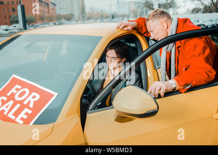 Father choosing a new car for his son. - Stock Photo