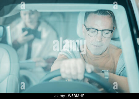 Man being late taking his wife to her work. - Stock Photo
