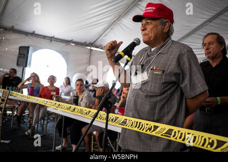 New Mexico, USA. 27th July, 2019. RAY BACA, Chairman of El Paso Hispanics for Trump, asks questions during a presentation at the Symposium at The Wall event next to the privately-funded fence along the U.S.-Mexico border in Sunland Park, New Mexico. Credit: ZUMA Press, Inc./Alamy Live News - Stock Photo