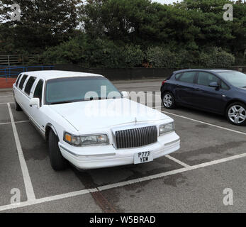 Stretch Limousine, Limo, Lincoln manufacture, car, vehicle, taking 2 bays, parking bays - Stock Photo