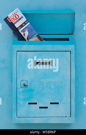 Mailbox with magazine, journal inside of it. Postal service concept. Safety of personal data background. Mail drop with newspaper, magazine. Mail doors background. Advertising concept - Stock Photo