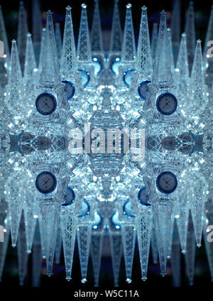 Kaleidoscopic image of a clock in a form of Eiffel Tower - Stock Photo