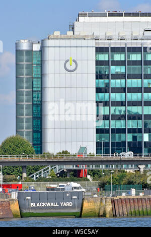 Blackwall Yard historical shipyard entrance on River Thames with Global Switch technology  business data centre building beyond East London England UK - Stock Photo