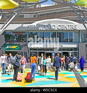 Diverse group of people on busy pedestrian crossing road in bright colours links Stratford Shopping Centre & stations & Westfield shops East London UK - Stock Photo