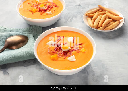 Salmorejo, Spanish cold tomato soup, with picos, traditional breadsticks - Stock Photo