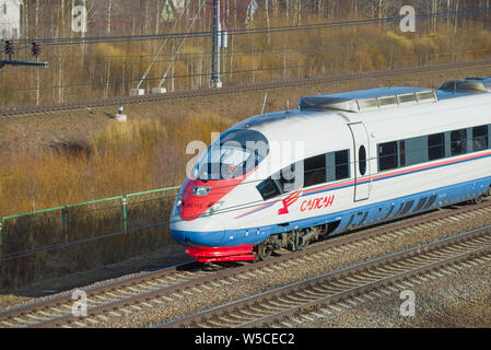 LENINGRAD REGION, RUSSIA - APRIL 10, 2018: The head car of the moving high-speed train EVS1-13 Sapsan close-up on a sunny April day. October Railway - Stock Photo