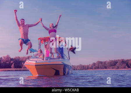 Young girl and her boyfriend from a holiday cruiser - Stock Photo