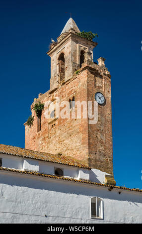 Medieval bell gable at Iglesia de Nuestra Señora de las Nieves, Gothic church in village of Alanis, Sierra Norte mountains, Andalusia, Spain - Stock Photo