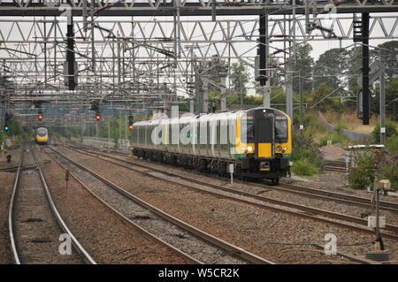 London Northwestern Railway Class 350 Desiro Units 350251 & 350255 form the 13:32 Crewe - London Euston service approaching Lichfield Trent Valley - Stock Photo