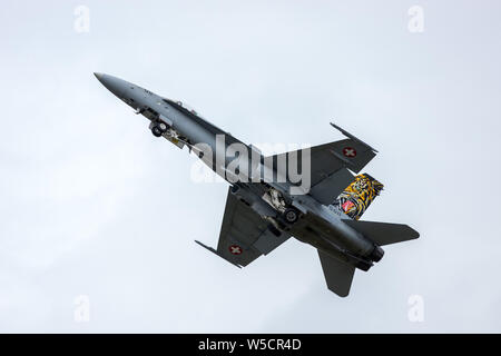 Swiss Air Force McDonnell Douglas F/A-18C seen just after take off at RAF Fairford for the 2019 RIAT - Stock Photo