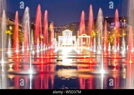 City of Nice cityscape and Fontaine Miroir d eau park evening view, Alpes-Maritimes region of France - Stock Photo
