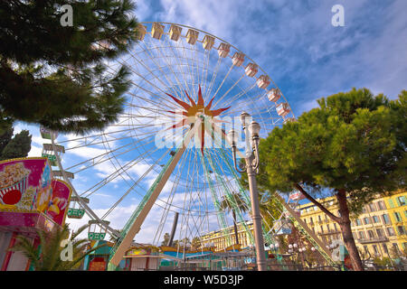 Nice ferris wheel and fun park view, Alpes-Maritimes region of France - Stock Photo