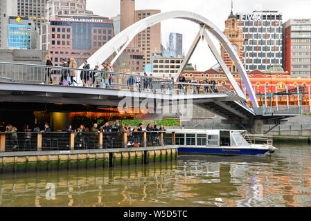 Melbourne cafe and boat on Yarra River, Melbourne, Victoria, Australia - Stock Photo
