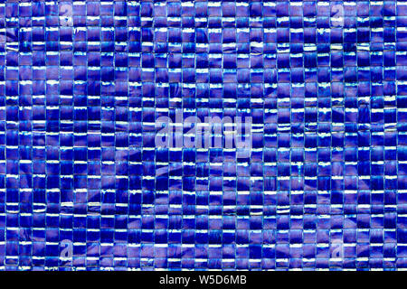 Texture of blue plastic net bag. Concept of recycle product or global warming.