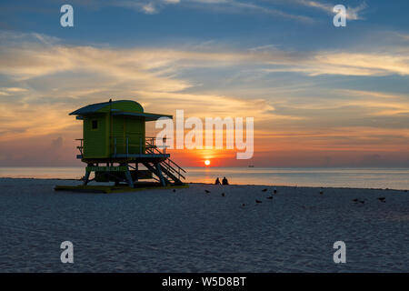 Miami Beach at sunrise and life guard tower, South Miami Beach, Florida. - Stock Photo