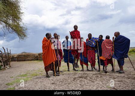 Traditional Masai Jumping Dance at a Masai Village, Tanzania, East Africa - Stock Photo