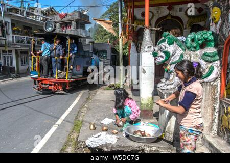 INDIA, DARJEELING. Historic narrow gauge toy train on its way from Darjeeling to Ghoom - Stock Photo