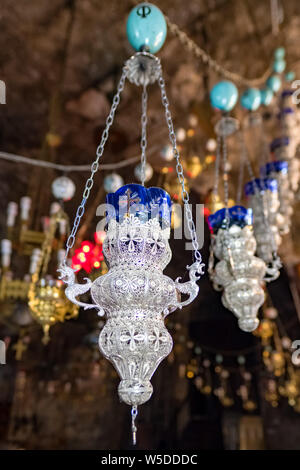 Old candle lamps at Church of the Sepulchre of Saint Mary, also Tomb of the Virgin Mary, in the Kidron Valley in Jerusalem, Israel - Stock Photo