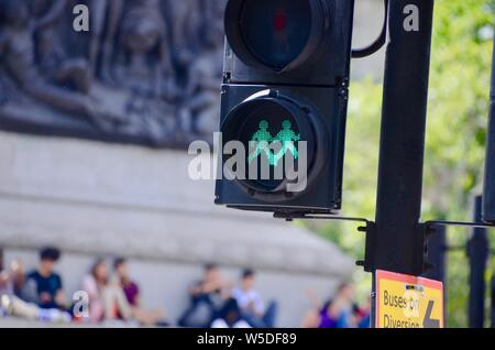 two green man figures on pedestrian crossing central london uk