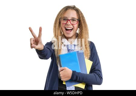 Back to school, isolated portrait of girl in school uniform glasses showing fingers victory sign - Stock Photo