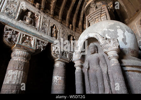 India, Maharashtra, Ajanta, Ajanta Caves. Interior view of ornate carvings and stone ceilings made to look like wooden beams. UNESCO. - Stock Photo